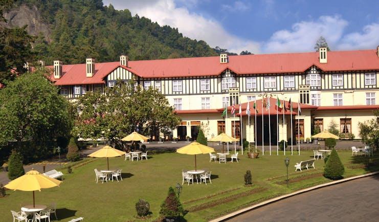 Grand Hotel Nuwara Eliya Sri Lanka exterior hotel building lawns hills in background