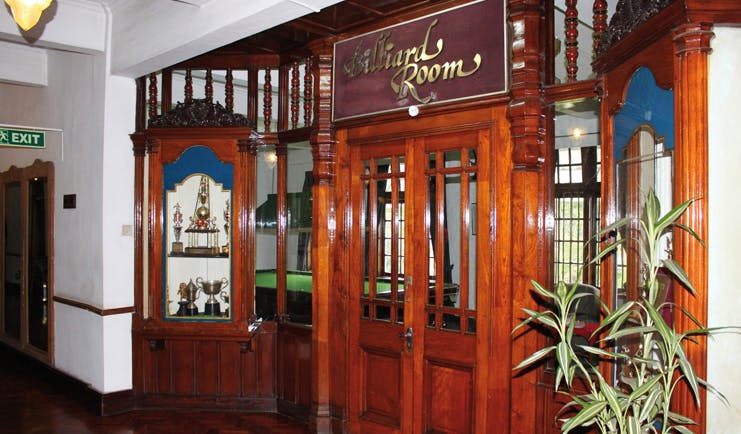Hotel Suisse Sri Lanka billiard room trophy cabinet