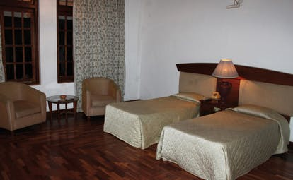 Hotel Suisse Sri Lanka twin bedroom armchairs minimalist decor