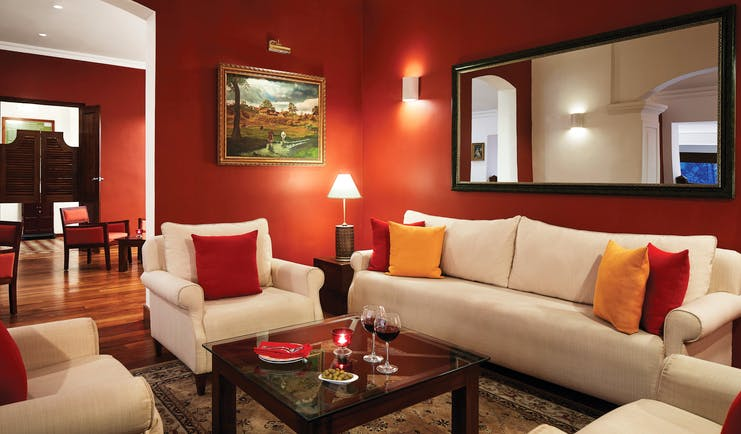 Bar area with red, cream and orange colour scheme and arm chairs set out