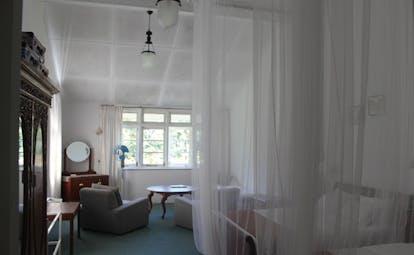 Kirchhayn Bungalow Sri Lanka bedroom mosquito drapes white decor armchairs
