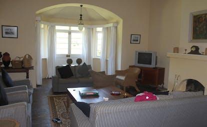 Kirchhayn Bungalow Sri Lanka lounge sofas traditional decor bay window fireplace