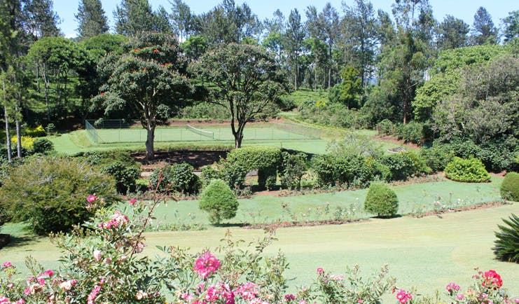 Kirchhayn Bungalow Sri Lanka tennis court from across lawned gardens