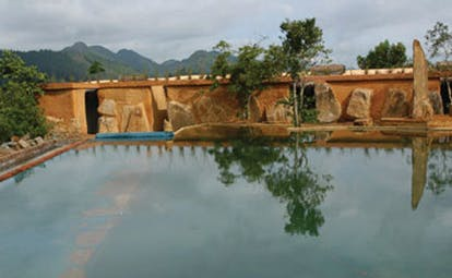Living Heritage Sri Lanka infinity pool overlooking edge of rainforest