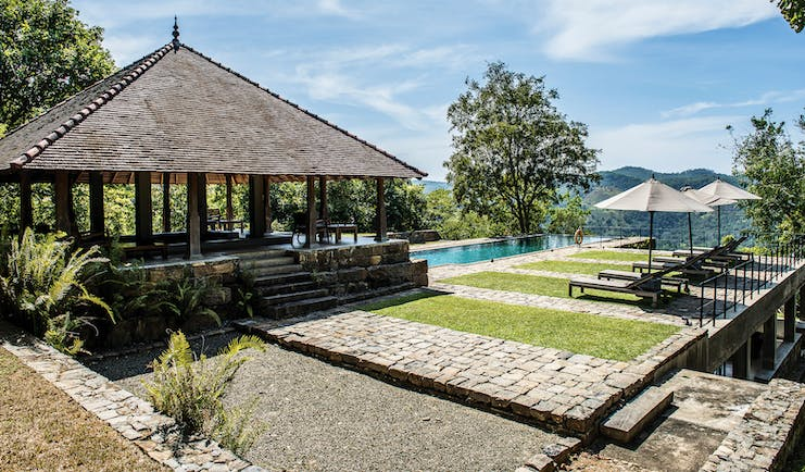 Living Heritage Sri Lanka pool side sun loungers lawns covered veranda countryside surrounds