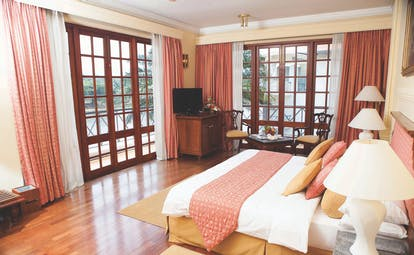 Mahaweli Reach Hotel deluxe room, double bed, modern decor