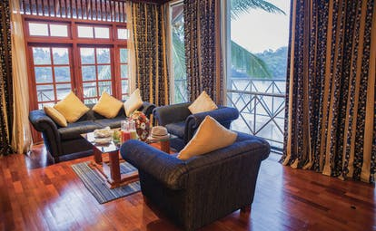 Mahaweli Reach Hotel executive suite, sofas, armchairs, view of river