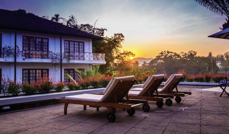 Mahaweli Reach Hotel poolside, sun loungers