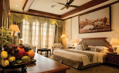 Mahaweli Reach Hotel presidential suite, double bed, traditional decor