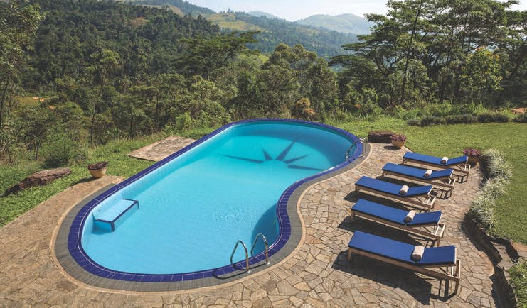 Taylor's Hill Sri Lanka pool terrace sun loungers countryside and mountains in background