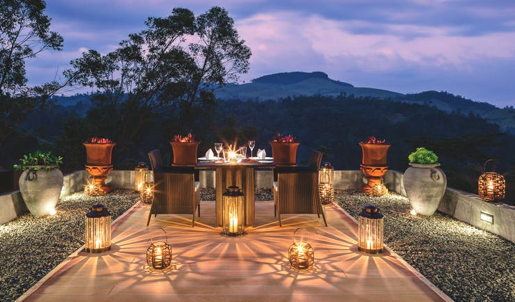 Taylor's Hill Sri Lanka terrace outdoor dining by night mountains in background