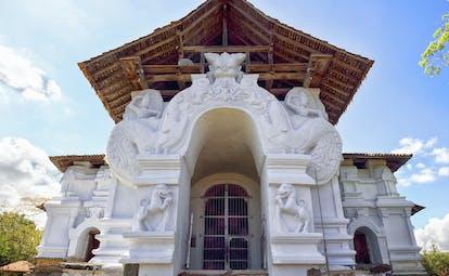 Lankatilaka Vihara temple white stone building, intricate carvings