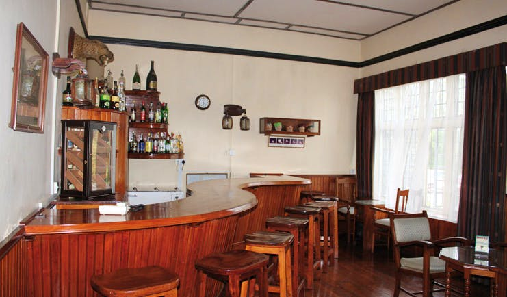 The Hill Club Sri Lanka bar area wood panelling traditional decor
