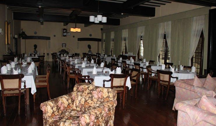 The Hill Club Sri Lanka main dining room restaurant traditional decor armchair
