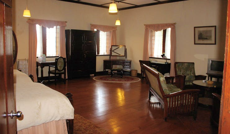 The Hill Club Sri Lanka south suite beds sofas traditional decor