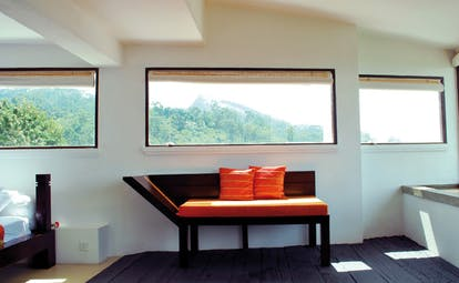 Theva Expressions Sri Lanka bedroom seating modern dark wood and orange sofa