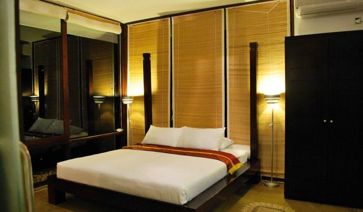 Theva Expressions Sri Lanka bedroom minimalist decor dark wood panoramic view