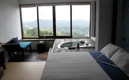 Theva Expressions Sri Lanka blue suite bed sofa jacuzzi forest view