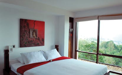Theva Expressions Sri Lanka double bedroom red painting with buddha hand panoramic view