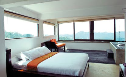 Theva Expressions Sri Lanka large bedroom minimalist decor wood sofa jacuzzi and panoramic views