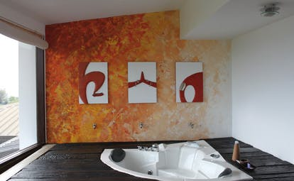 Theva Expressions Sri Lanka orange suite painted wall modern artwork jacuzzi