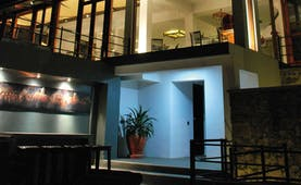 Theva Expressions Sri Lanka outdoor view artwork and large windows to hotel at night