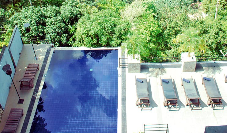 Theva Expressions Sri Lanka rooftop pool loungers forest view