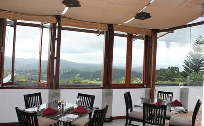 Theva Expressions Sri Lanka Theva restaurant indoor dining room panoramic mountain view