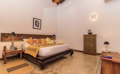 Aditya Resort sagara suite, double bed, antique sri lankan furniture, elegant decor