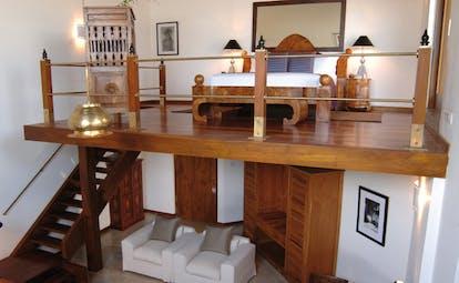 Aditya Resort surya mezzanine room with sofa downstairs and bedroom upstairs