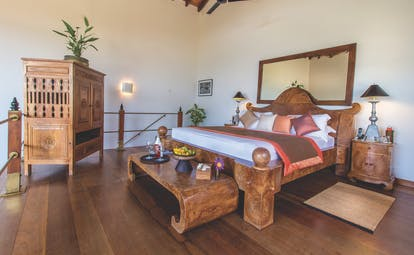 Aditya Resort surya suite, double bed with wooden frame, antique furniture, elegant decor