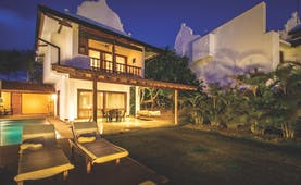 Aditya Resort villa exterior, verandah, pool, sun loungers