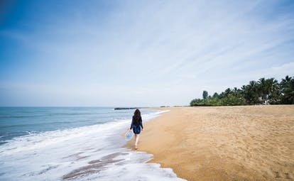 Anantara Kalutara Sri Lanka beach sand sea woman walking on the sand
