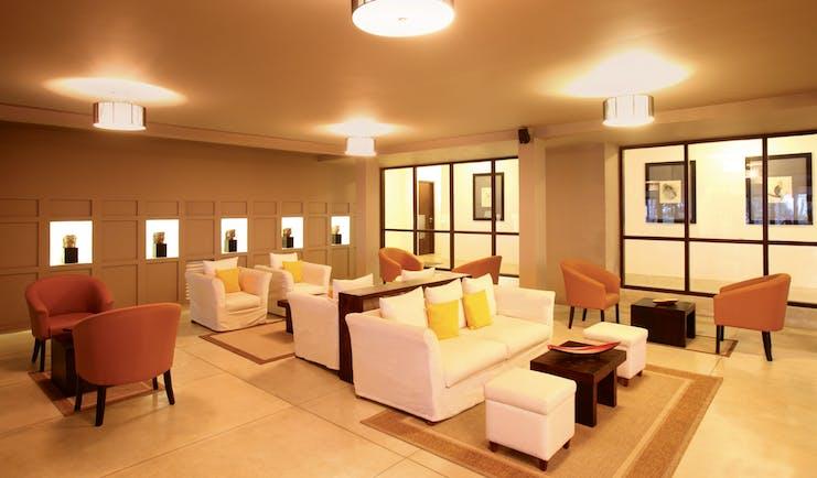 Avani Bentota Sri Lanka lounge indoor communal seating area sofas chairs chic modern decor