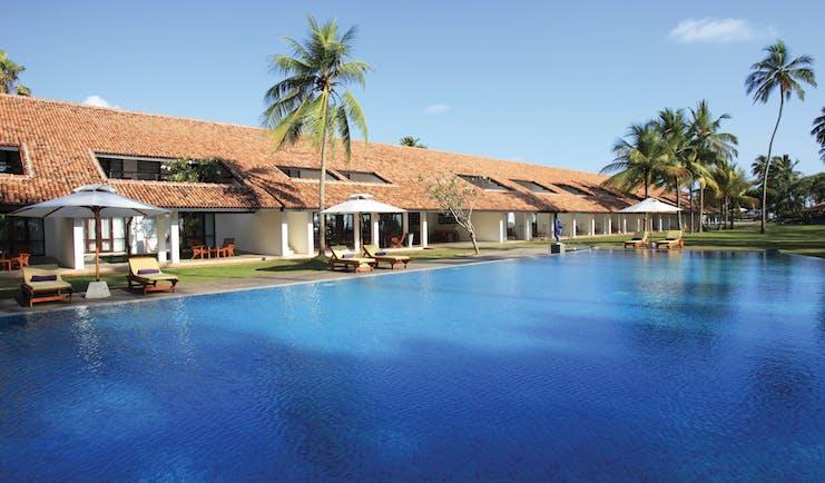 Avani Bentota Sri Lanka pool sun loungers umbrellas palm trees