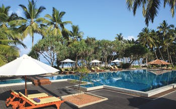 Avani Bentota Sri Lanka poolside sun loungers umbrellas beach in background