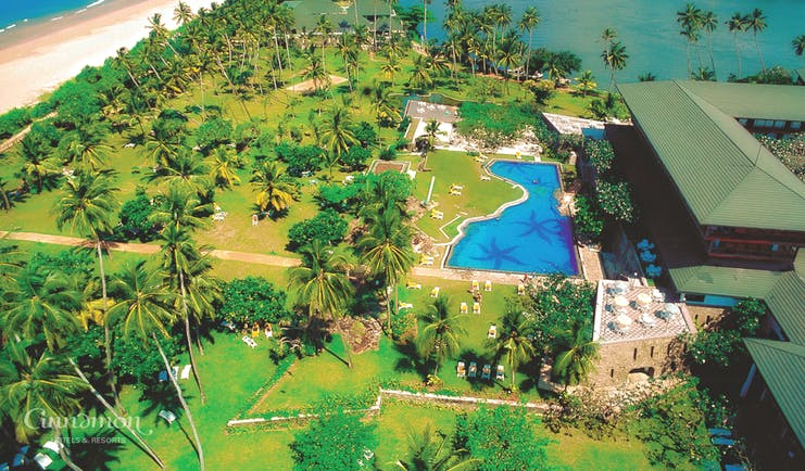 Bentota Beach Sri Lanka aerial shot of resort hotel building pool lake beach gardens