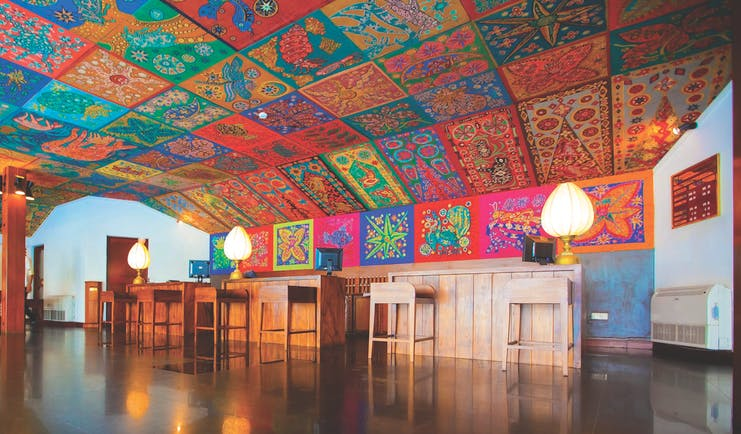 Bentota Beach Sri Lanka lobby reception desks ornate colourful ceiling
