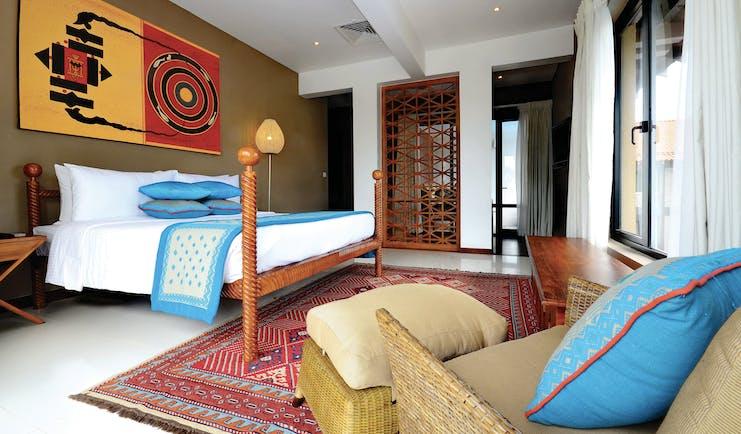 Cinnamon Bey Sri Lanka suite bedroom bed armchair modern décor