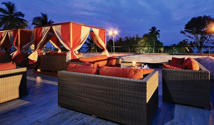 Cinnamon Bey Sri Lanka rooftop terrace sofas night lights