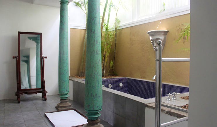 Club Villa Sri Lanka bathroom with columns freestanding mirror and blue tiled bath