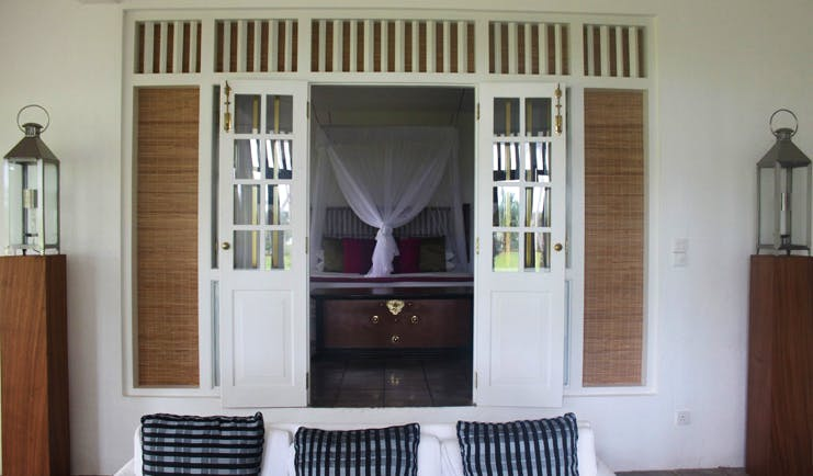Club Villa Sri Lanka Club Suite lounge sofas with window to bedroom