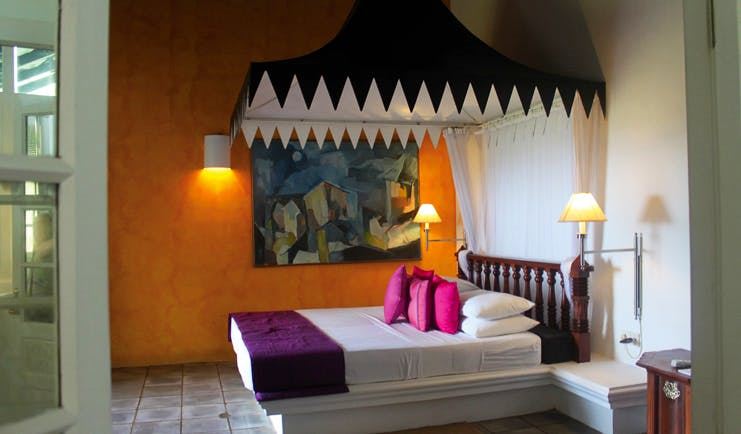 Club Villa Sri Lanka deluxe bedroom with canopy and tiled floors