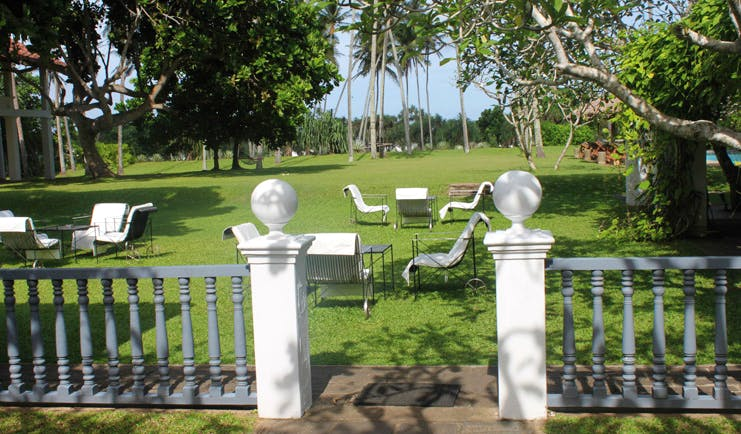 Club Villa Sri Lanka garden lawn area lounge chairs and trees