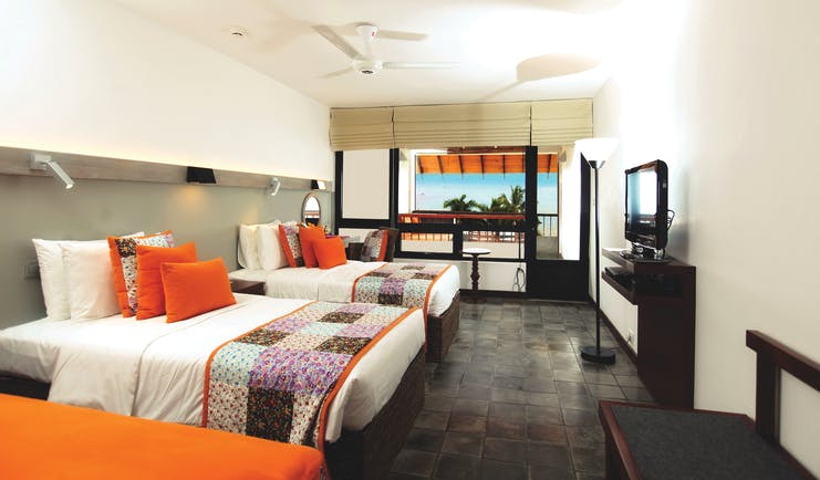 Hikka Tranz Sri Lanka superior room two beds modern décor access to private terrace