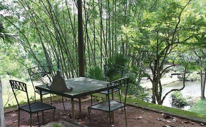 Lunuganga Sri Lanka garden patio view of trees and pond