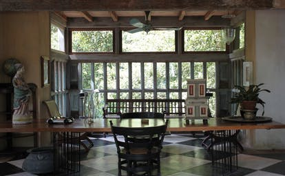 Lunuganga Sri Lanka garden room lounge with chequerboard tiled floor and antiques