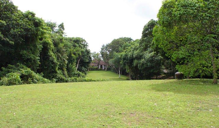 Lunuganga Sri Lanka house exterior lawn view of white building