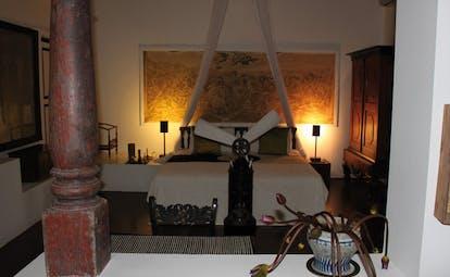 Lunuganga Sri Lanka main house bedroom with large painting fan and canopy