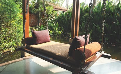 Reef Villa and Spa bench swing, suspended bench overlooking ponds